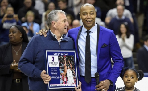 Former head coach Jim Calhoun congratulates Caron Butler after Butler was honored by having his name placed up on the Huskies Wall of Honor at halftime during the Huskies game against Tulsa at Gample Pavilion Saturday night. (John Woike / Hartford Courant)