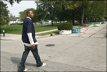 The Wizards' Caron Butler walks by his youth hangout in Racine, Wis., where there was plenty of criminal activity. Butler made his first drug deal at age 11 and was in juvenile court 15 times before age 15.
